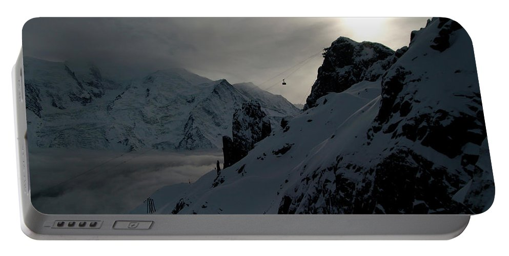 Brevent Portable Battery Charger featuring the photograph Backlit Skilift In Beautiful Landscape by Patrik Lindqvist