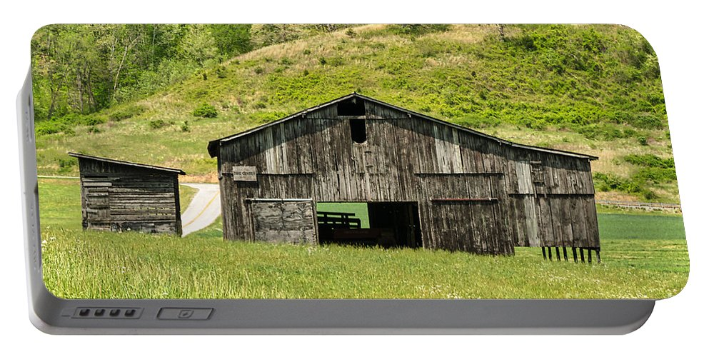 Architecture Portable Battery Charger featuring the photograph Barn - Tire Center by Mary Carol Story