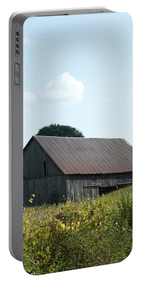 Barn Portable Battery Charger featuring the photograph Barn In The Grass by Linda Kerkau
