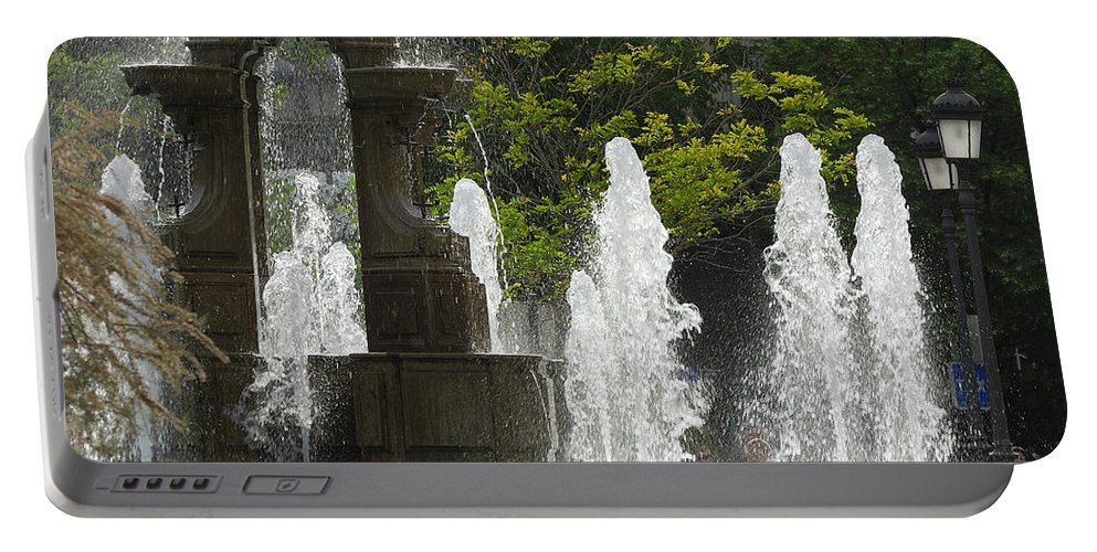 Battle Portable Battery Charger featuring the photograph Battle Fountain by Guido Montanes Castillo