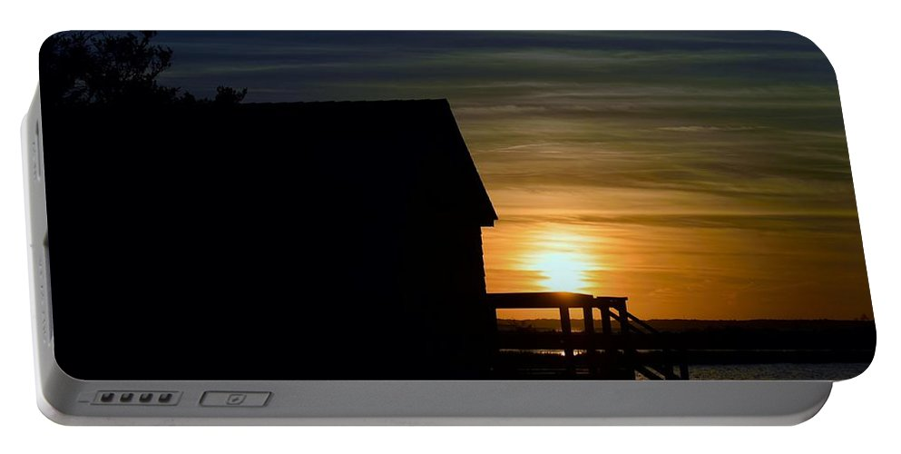 Silhouette Portable Battery Charger featuring the photograph Beach Shack Silhouette by William Bartholomew