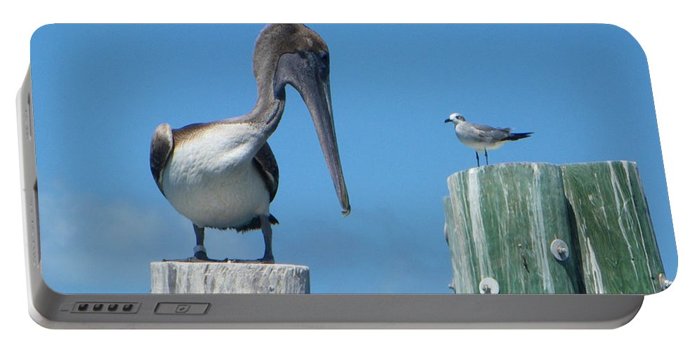 Pelican Portable Battery Charger featuring the photograph Beat It by Greg Graham