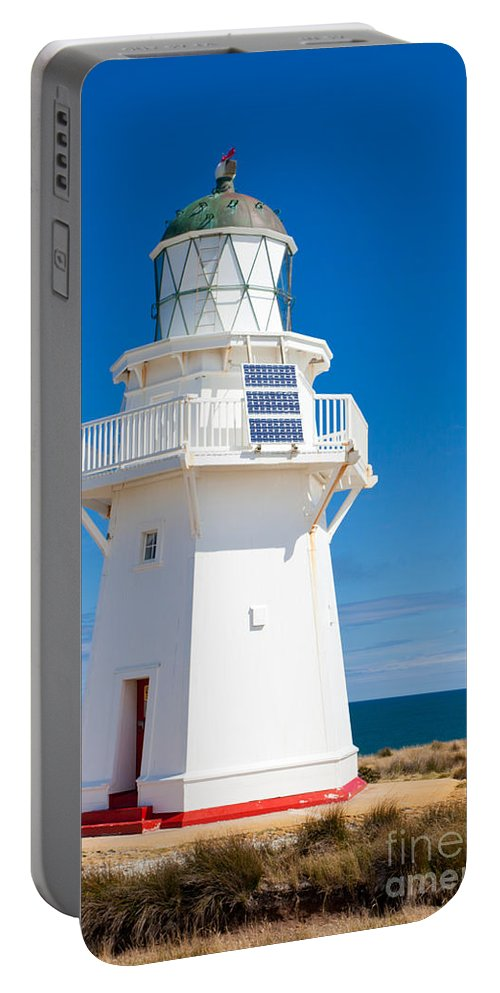South Island Portable Battery Charger featuring the photograph Beautiful Wairapa Point Lighthouse The Catlins Nz by Stephan Pietzko