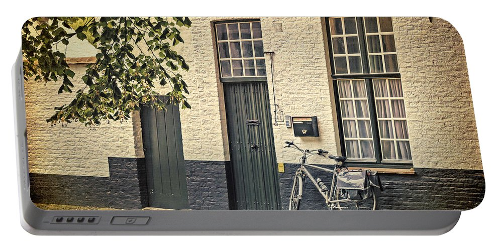 Bicycle Portable Battery Charger featuring the photograph Begijnhof Bicycle by Joan Carroll