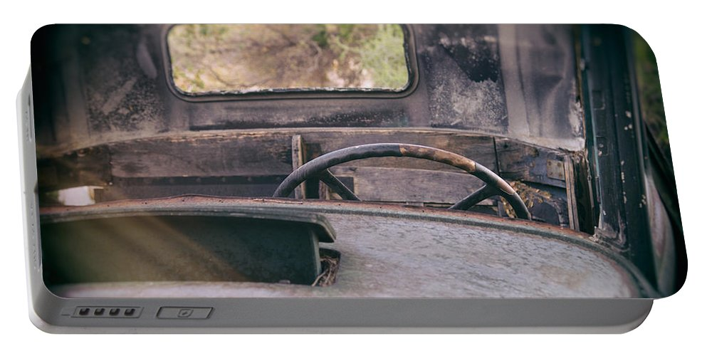 Abandoned Portable Battery Charger featuring the photograph Behind The Wheel by Peter Tellone