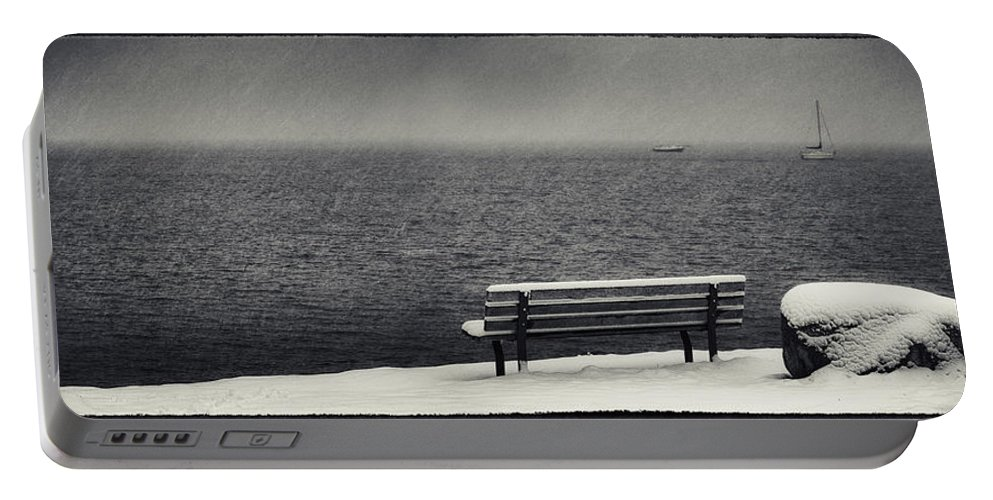 Bench Rock And Sailing Boat Portable Battery Charger featuring the photograph Bench On The Winter Shore by Peter v Quenter