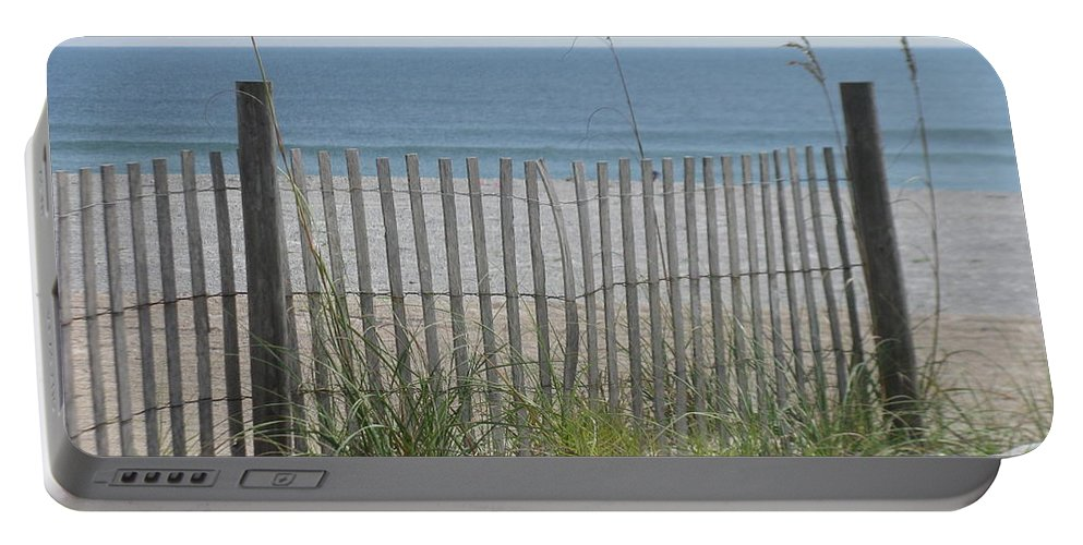 Landscape Portable Battery Charger featuring the photograph Bent Beach Fence by Ellen Meakin