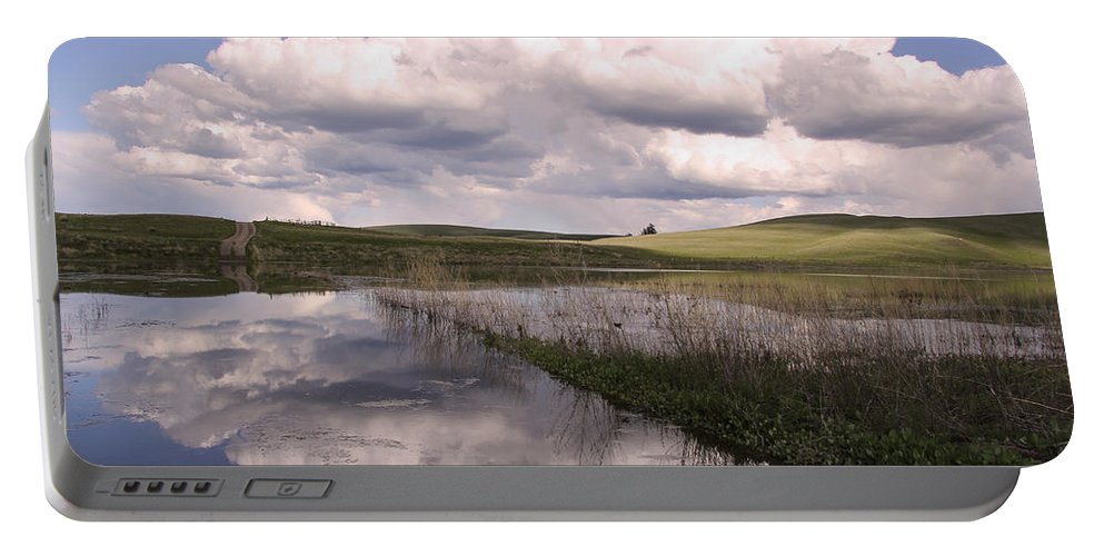 Landscape Portable Battery Charger featuring the photograph Between Storms by Kathy Bassett