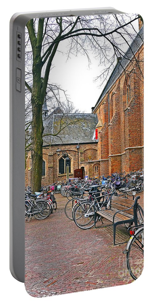 Travel Portable Battery Charger featuring the photograph Bicycling To Church by Elvis Vaughn