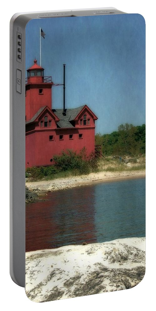 Michigan Portable Battery Charger featuring the photograph Big Red Holland Michigan Lighthouse by Michelle Calkins