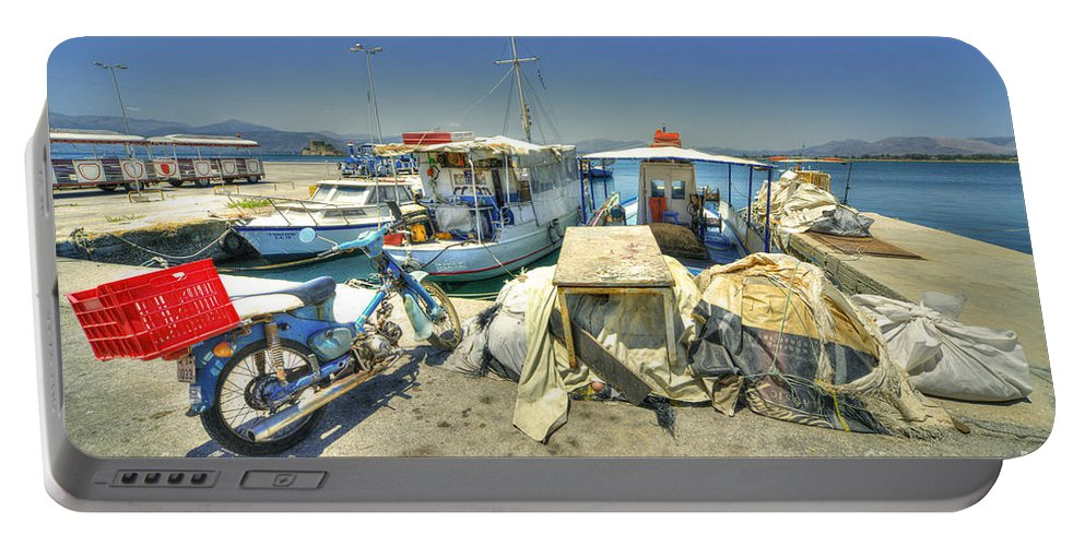 Nafplion Portable Battery Charger featuring the photograph Bike And Boats At Nafplion Harbour by Rob Hawkins