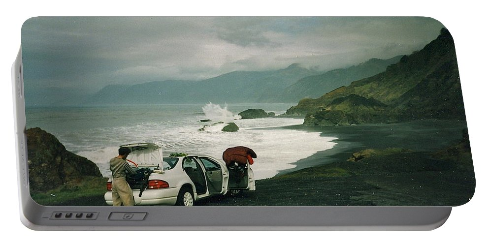 Spectacular Portable Battery Charger featuring the photograph Black Sands Beach by Susan Wyman