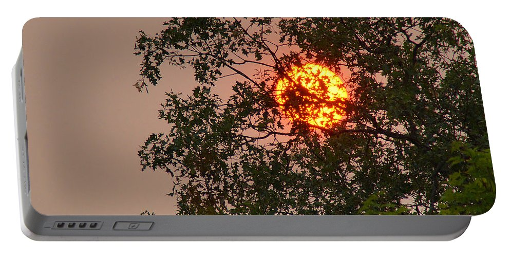 Blazing Portable Battery Charger featuring the photograph Blazing Sun Hiding Behind A Tree by Mick Anderson