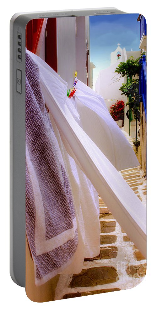 Mykonos Portable Battery Charger featuring the photograph Blowing In The Wind by Madeline Ellis