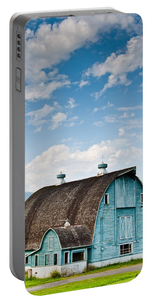 Agricultural Activity Portable Battery Charger featuring the photograph Blue Barn In The Stillaguamish Valley by Jeff Goulden
