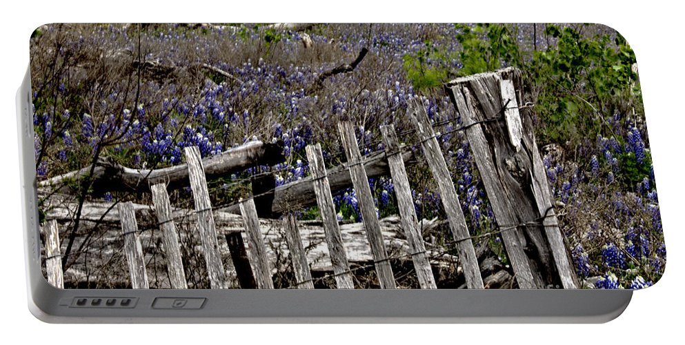 Wildflowers Portable Battery Charger featuring the photograph Blue Bonnet Fence by Douglas Barnard