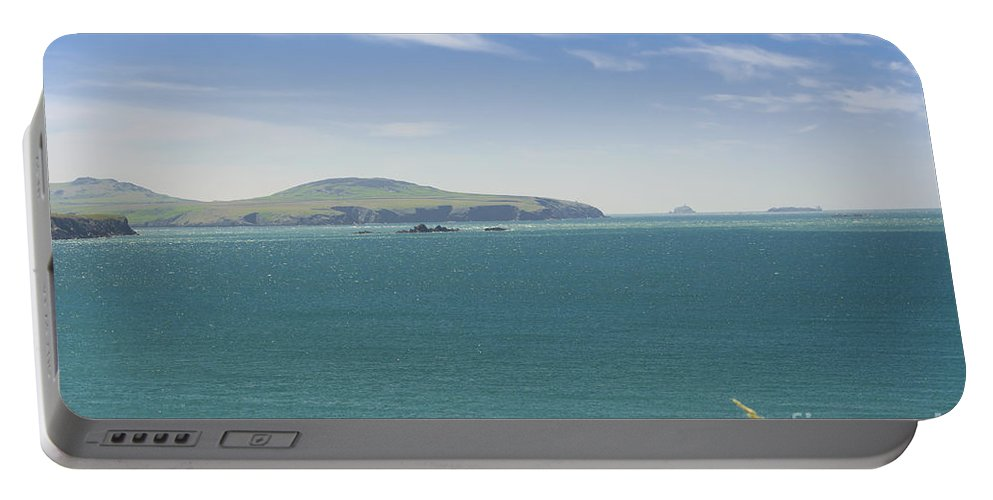 Cliff Portable Battery Charger featuring the photograph Blue Breeze by Mair Hunt
