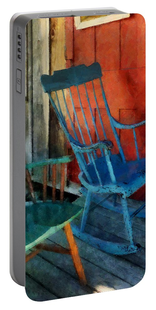 Porch Portable Battery Charger featuring the photograph Blue Chair Against Red Door by Susan Savad