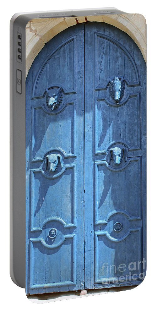 Blue Door Portable Battery Charger featuring the photograph Blue Door Decorated With Wooden Animal Heads by Christiane Schulze Art And Photography