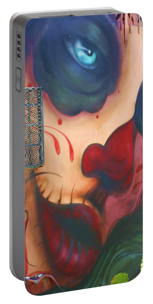 Graffiti Portable Battery Charger featuring the photograph Blue Eyed Skull by Chuck Hicks