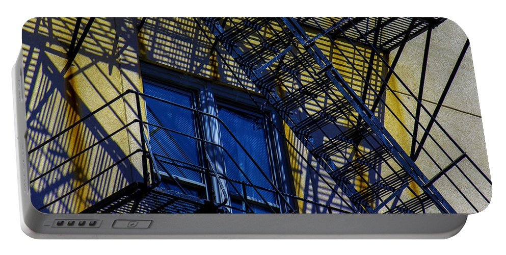 Portable Battery Charger featuring the photograph Blue Fire Escape by Raymond Kunst