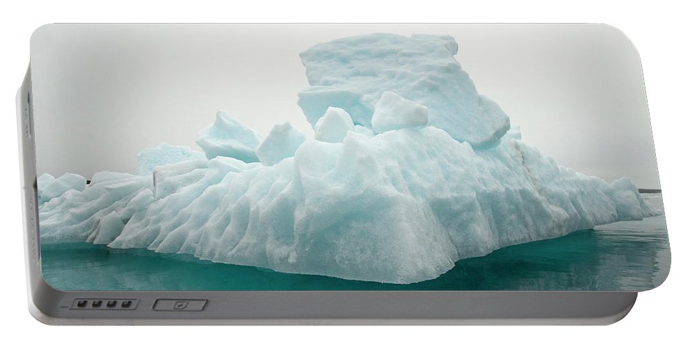 Archipelago Portable Battery Charger featuring the photograph Blue Glacial Iceberg Floating by Steven J. Kazlowski / GHG