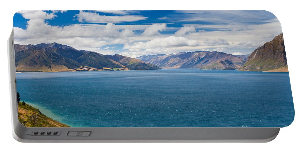 South Island Portable Battery Charger featuring the photograph Blue Surface Of Lake Hawea In Central Otago Of New Zealand by Stephan Pietzko