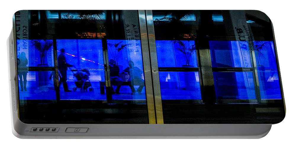 Las Vegas Portable Battery Charger featuring the photograph Blue Tram Windows by Angus Hooper Iii