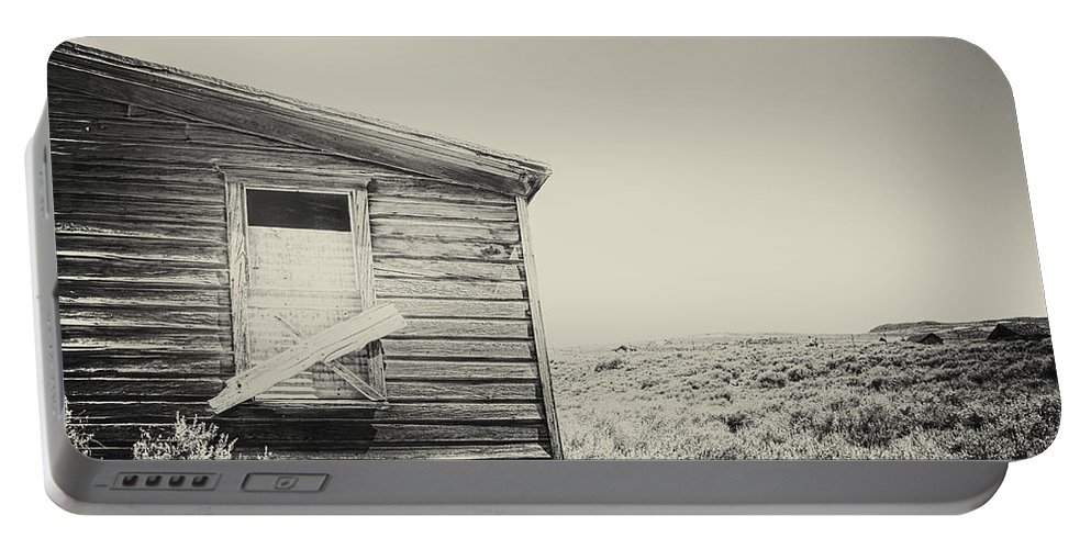 Structure; Wood; Wooden; Country; Countryside; Desert; Deserted; Worn; Abandoned; Boards; Ruins; Boarded Up; Grasses; Hills; House; Home; Sepia; Rural; Vast; Dirt; Window; Sky; Vintage; Antique Portable Battery Charger featuring the photograph Boarded by Margie Hurwich