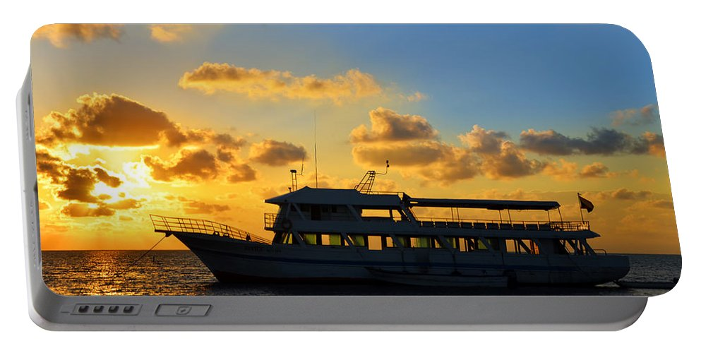 Boats Portable Battery Charger featuring the photograph Boat At Sunrise by Jess Kraft