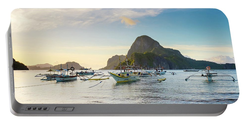 Water Portable Battery Charger featuring the photograph Boats Anchored In Bacuit Bay And Cadlao by Jason Langley