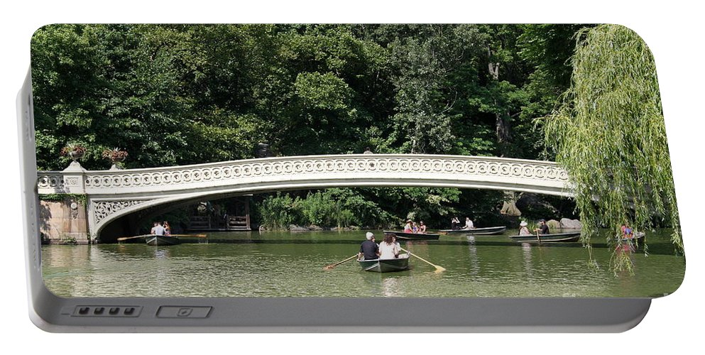 Bow Bridge Portable Battery Charger featuring the photograph Bow Bridge And Row Boats by Christiane Schulze Art And Photography