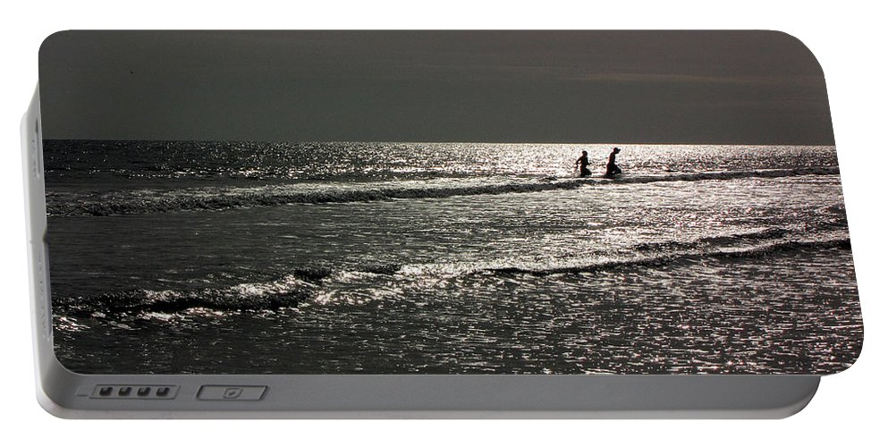 Ocean Portable Battery Charger featuring the photograph Boys by Sarah Houser