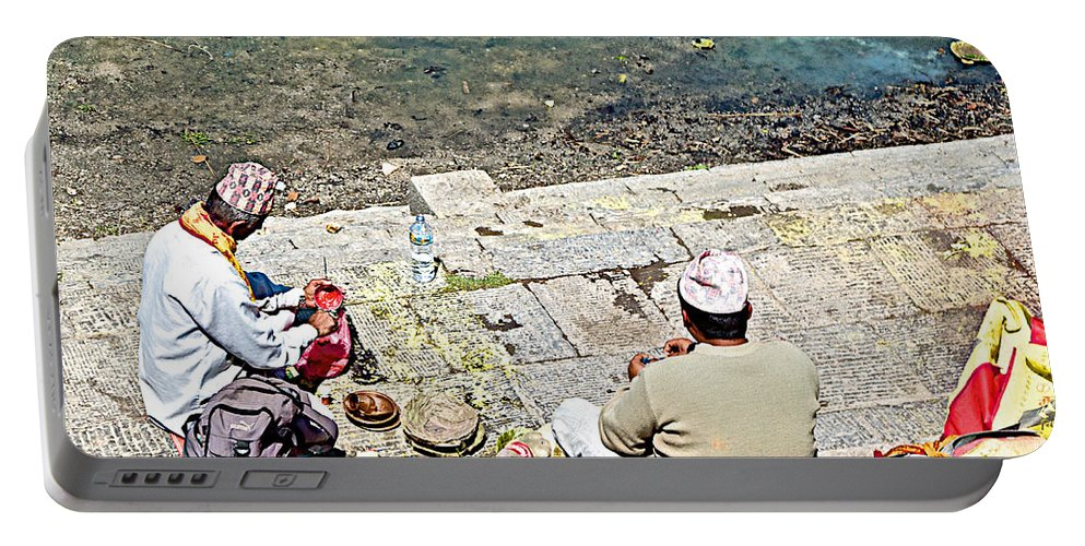 Brahmans Along Bagmati River In Pasupatinath Temple Of Cremation Complex In Kathmandu In Nepal Portable Battery Charger featuring the photograph Brahmans Along Bagmati River In Pasupatinath Temple Of Cremation Complex In Kathmandu-nepal by Ruth Hager