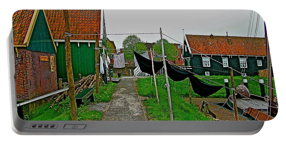 Breeches Out To Dry In Zuiderzee Open Air Musuem In Enkhuizen Portable Battery Charger featuring the photograph Breeches Out To Dry In Zuiderzee Open Air Musuem In Enkhuizen-ne by Ruth Hager