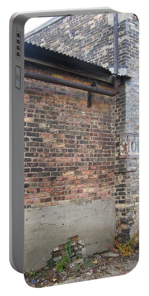 Brick Portable Battery Charger featuring the photograph Brick Building Stop by Anita Burgermeister