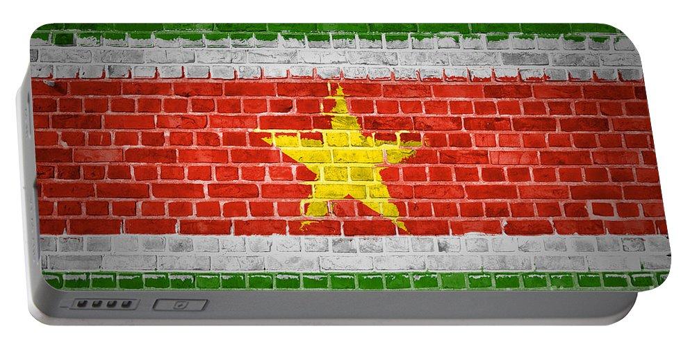 Suriname Portable Battery Charger featuring the digital art Brick Wall Suriname by Antony McAulay