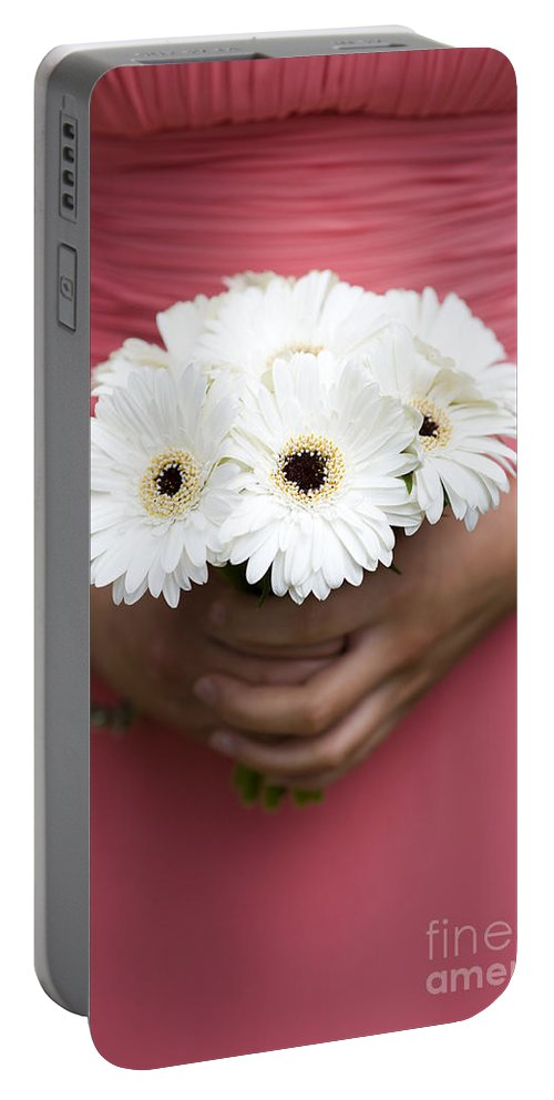 Gerbera Portable Battery Charger featuring the photograph Bridesmaid Holding A Bouquet Of Berbera by Lee Avison