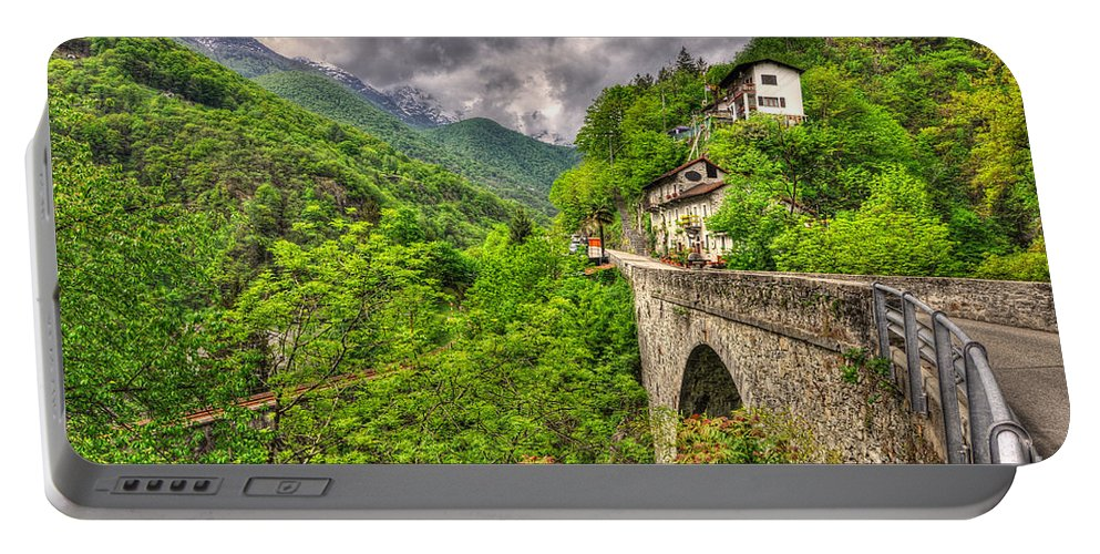 Bridge Portable Battery Charger featuring the photograph Bridge And Mountain by Mats Silvan