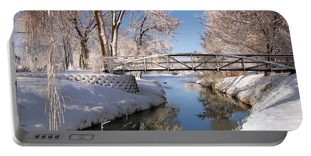 Snow Portable Battery Charger featuring the photograph Bridge Over Icy Water by John Absher