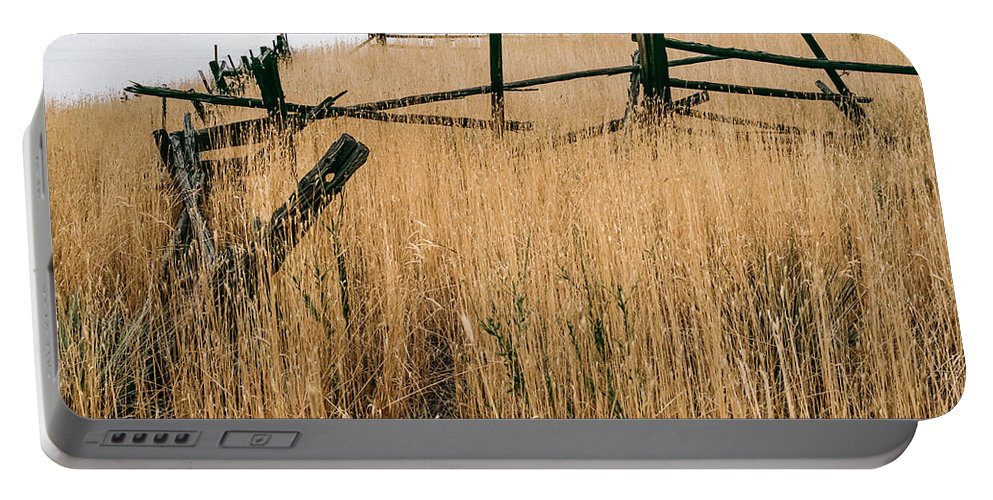 Cedar Fences Portable Battery Charger featuring the photograph Broken Down Fence by Robert VanDerWal