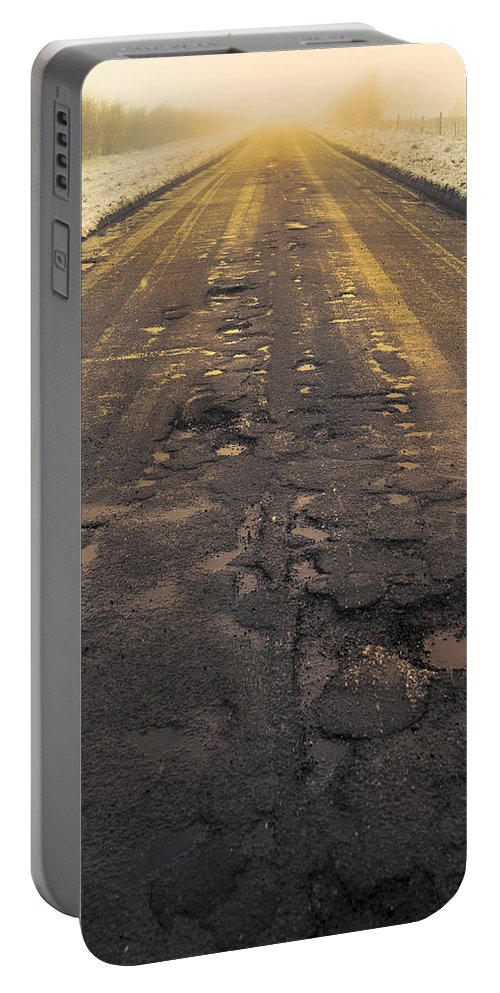 Cold Portable Battery Charger featuring the photograph Broken Road by Svetlana Sewell