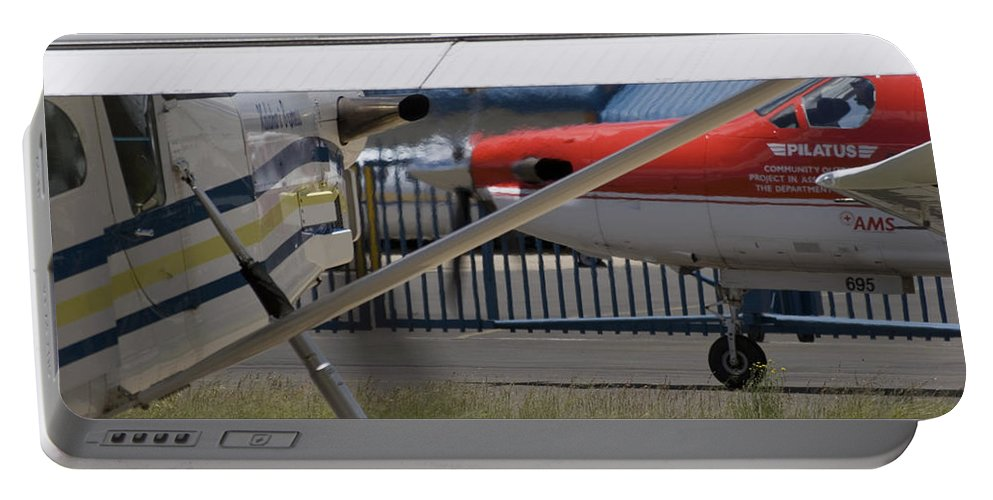 Pilatus Pc 12 Portable Battery Charger featuring the photograph Brother And Sister by Paul Job