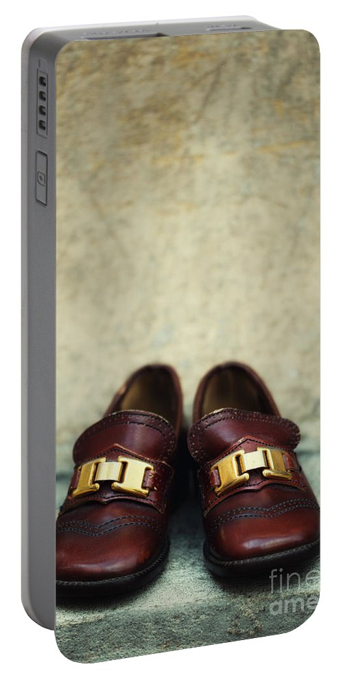 Vertical Portable Battery Charger featuring the photograph Brown Children Shoes by Jaroslaw Blaminsky
