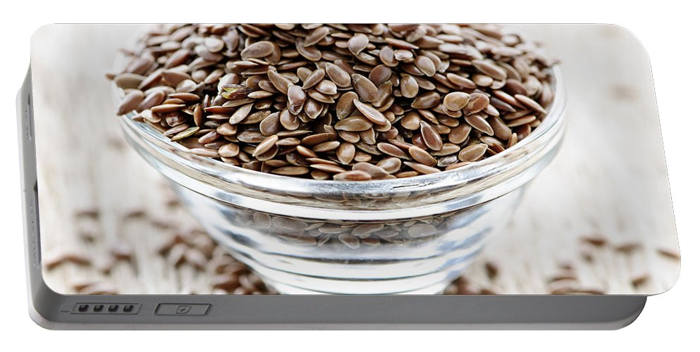 Flax Portable Battery Charger featuring the photograph Brown Flax Seed by Elena Elisseeva
