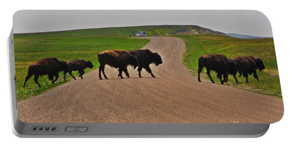 Buffalo Crossing Portable Battery Charger featuring the photograph Buffalo Crossing by John Malone