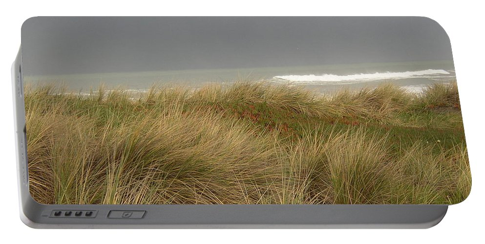 Nature Portable Battery Charger featuring the photograph By The Sea by Nancy Worrell