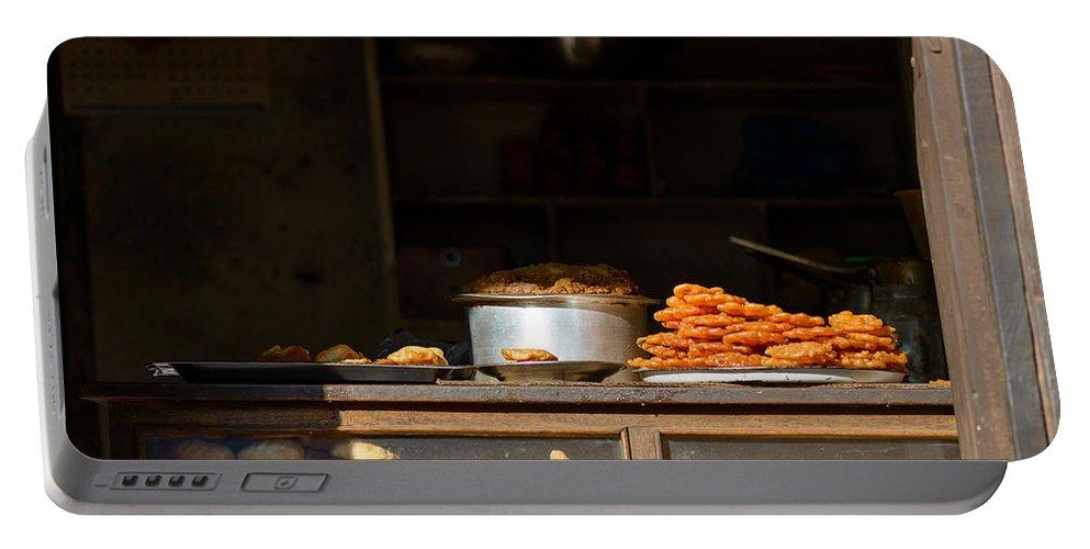 Kathmandu Portable Battery Charger featuring the photograph Cake Shop In Kathmandu by Dutourdumonde Photography