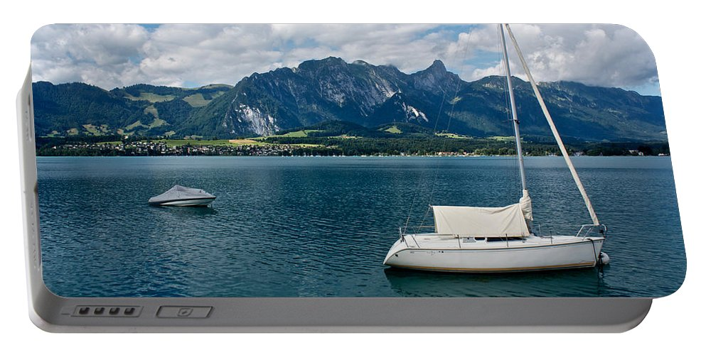 Calm Portable Battery Charger featuring the photograph Calm Water by Brady Lane