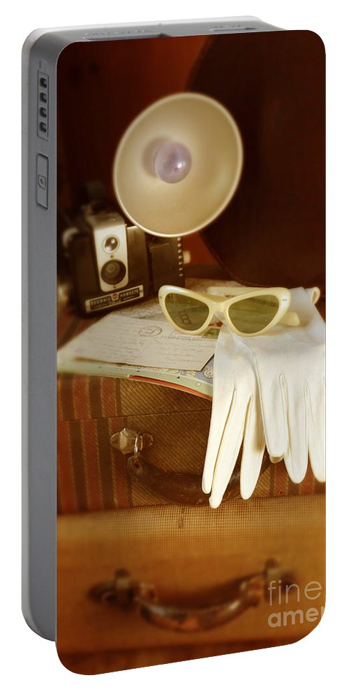 Sunglasses Portable Battery Charger featuring the photograph Camera Sunglasses On Luggage by Jill Battaglia